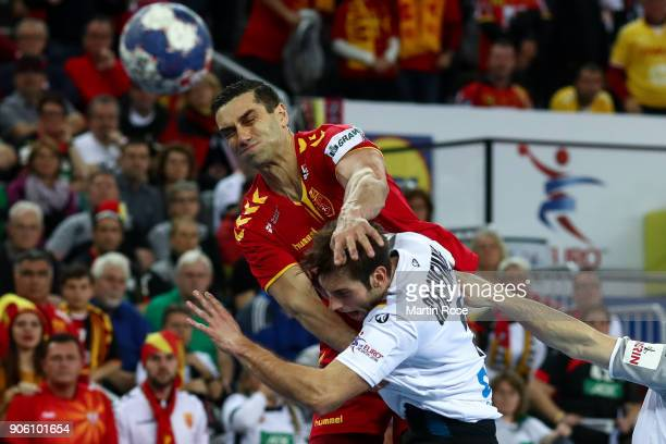 Kiril Lazarov of Macedonia is challenged by Uwe Gensheimer of Germany during the Men's Handball European Championship Group C match between Germany...