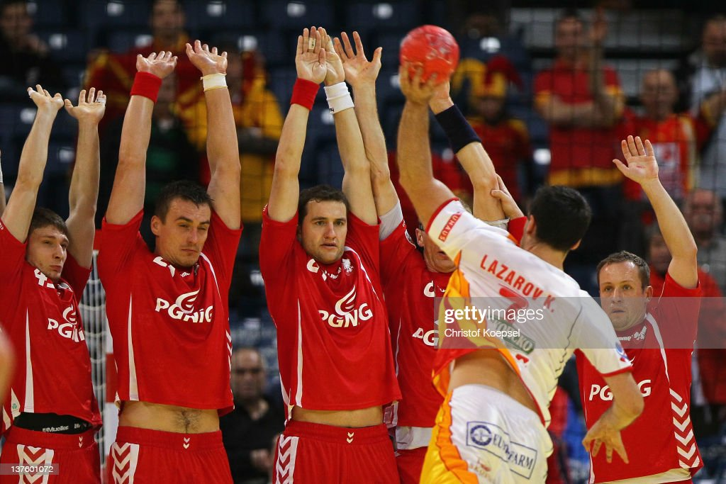 Kiril Lazarov of Macedonia throws against the polish wall during the Men's European Handball Championship second round group one match between Poland and Macedonia at Beogradska Arena on January 23, 2012 in Belgrade, Serbia.