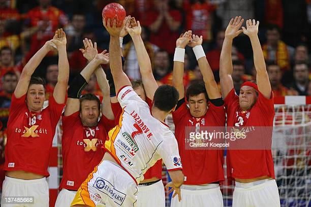 Kiril Lazarov of Macedonia throws against the wall of Denmark during the Men's European Handball Championship second round group one match between...
