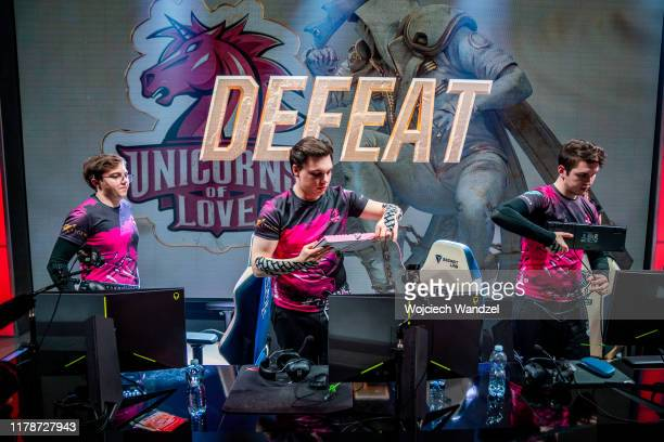 Kirill AHaHaCiK Skvortsov Lev Nomanz Yakshin and Nihat Innaxe Aliev pack away their equipment after a loss against Mammoth in the League of Legends...