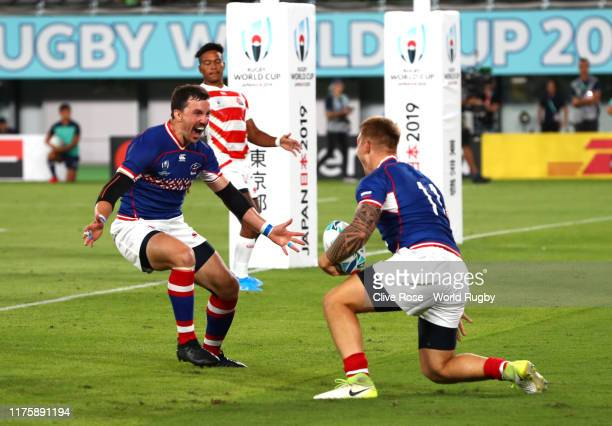Kirill Golosnitskiy of Russia celebrates scoring his side's first try with his team mate Vasily Artemyev during the Rugby World Cup 2019 Group A game...