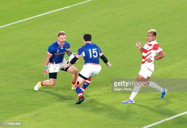 Kirill Golosnitskiy of Russia celebrates with teammate Vasily Artemyev after scoring his team's first try during the Rugby World Cup 2019 Group A...