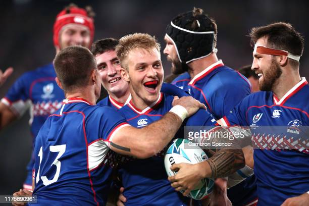 Kirill Golosnitskiy of Russia celebrates with teammates after scoring his team's first try during the Rugby World Cup 2019 Group A game between Japan...