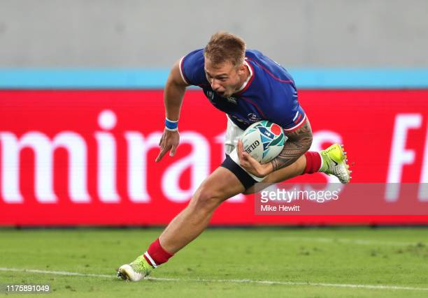 Kirill Golosnitskiy of Russia on his way to scoring his team's first try during the Rugby World Cup 2019 Group A game between Japan and Russia at the...