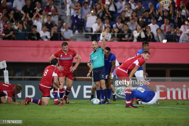 Kirill Gotovtsev of Russia is sent to the sin bin after receving a yellow card from referee Romain Poite as Afaesetiti Amosa of Samoa celebrates...