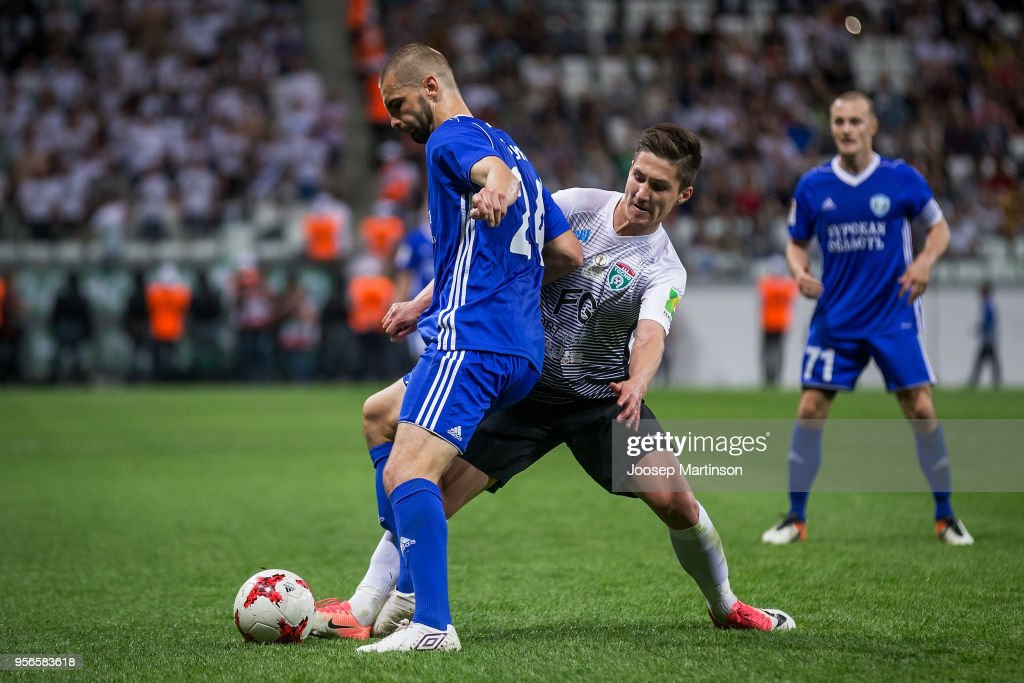 Kirill Gotsuk of FC Avangard competes with Vagiz Galiulin of FC Tosno during Russian Cup Final match between FC Tosno and Fc Avangard at Volgograd Arena on May 9, 2018 in Volgograd, Russia.