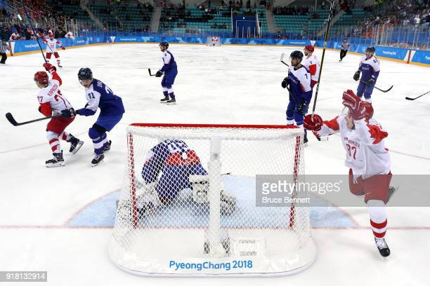 Kirill Kaprizov and Vadim Shipachyov of Olympic Athlete from Russia celebrate a goal by Kaprizov in the first period against Branislav Konrad of...