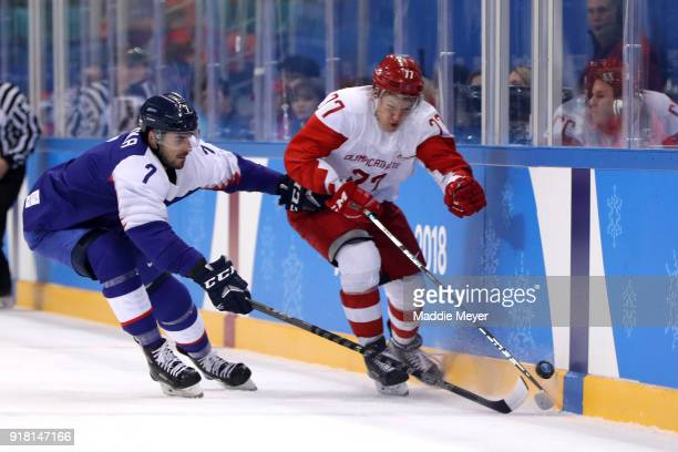 Kirill Kaprizov of Olympic Athlete from Russia competes for the puck with Ivan Baranka of Slovakia in the second period during the Men's Ice Hockey...