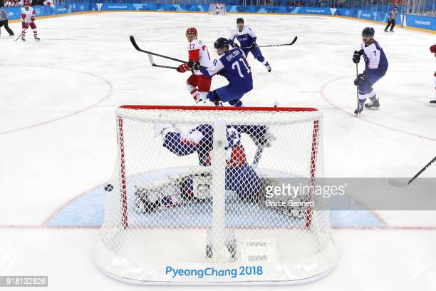 Kirill Kaprizov of Olympic Athlete from Russia scores a goal in the first period against Branislav Konrad of Slovakia during the Men's Ice Hockey...