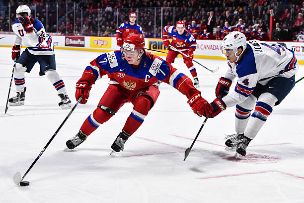 aa9a724d323 Kirill Kaprizov  7 of Team Russia protects the puck from Caleb Jones  4 of