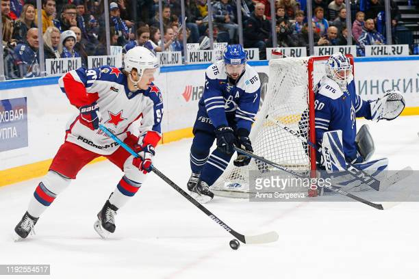 Kirill Kaprizov of the CSKA Moscow plays the puck against Kirill Lyamin of the Dynamo Moscow at the Arena VTB Moscow on January 8, 2020 in Moscow,...