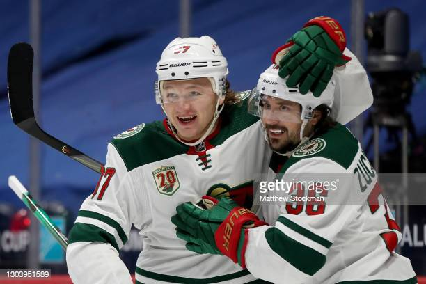 Kirill Kaprizov of the Minnesota Wild congratulates Mats Zuccarello after his goal against the Colorado Avalanche in the first period at Ball Arena...