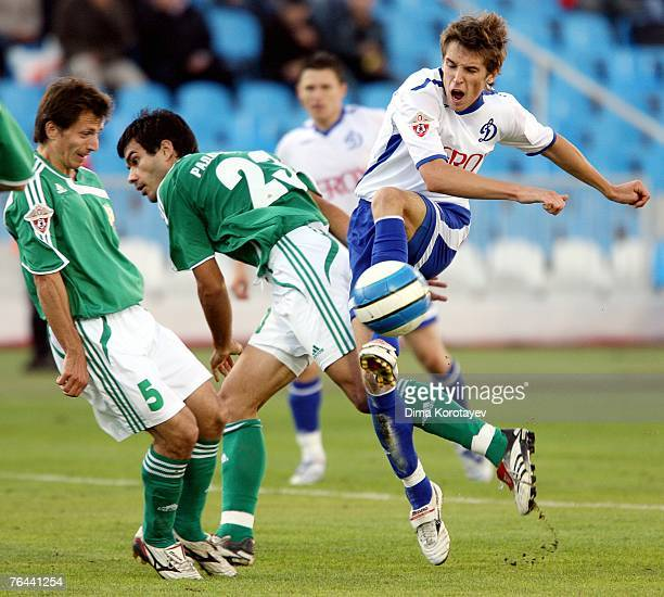 Kirill Kombarov of FC Dynamo Moscow competes for the ball with Aleksandar Radosavljevic and Sergei Skoblyakov of FC Tom Tomsk during the Russian...