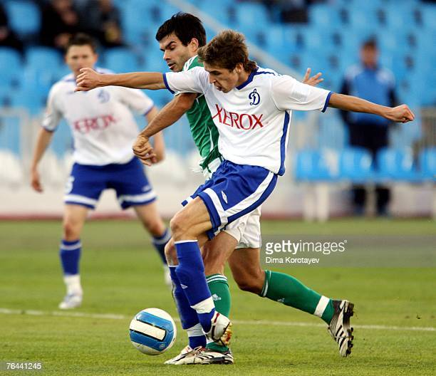 Kirill Kombarov of FC Dynamo Moscow competes for the ball with Aleksandar Radosavljevic of FC Tom Tomsk during the Russian Football League...