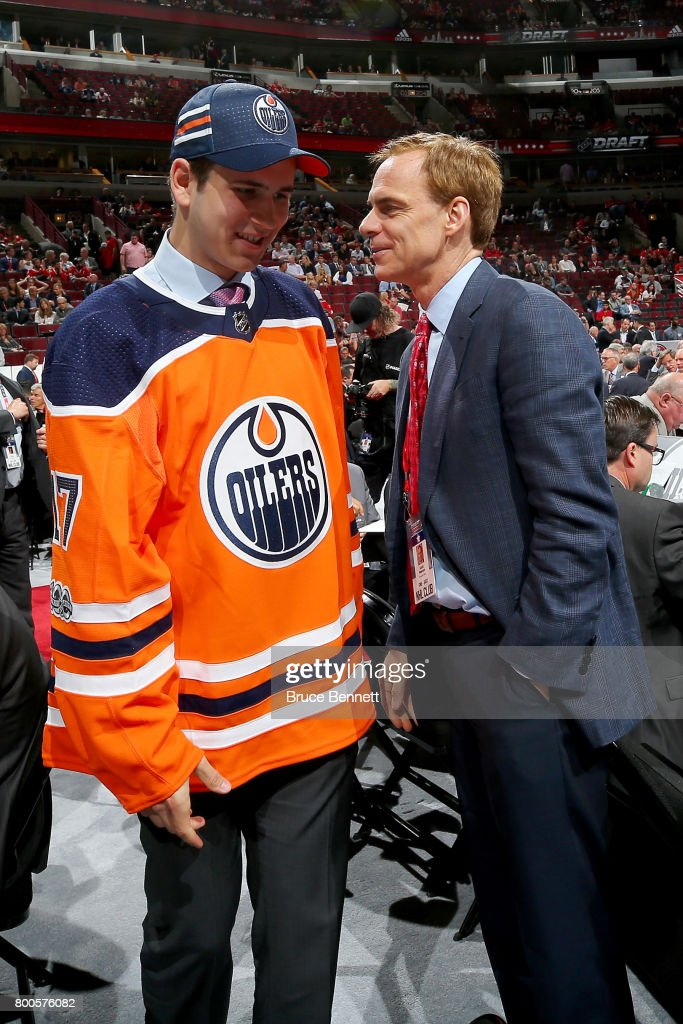 Kirill Maksimov meets with executive Scott Howson after being selected 146th overall by the Edmonton Oilers during the 2017 NHL Draft at the United Center on June 24, 2017 in Chicago, Illinois.