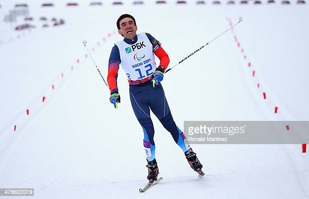 Kirill Mikhaylov of Russia crosses the finish line in the Men's 15km Standing Biathlon during day seven of Sochi 2014 Paralympic Winter Games at...