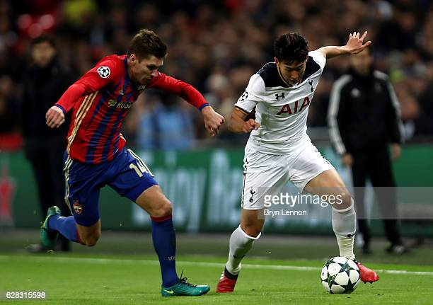 Kirill Nababkin of CSKA Moscow and HeungMin Son of Tottenham Hotspur battle for possession during the UEFA Champions League Group E match between...