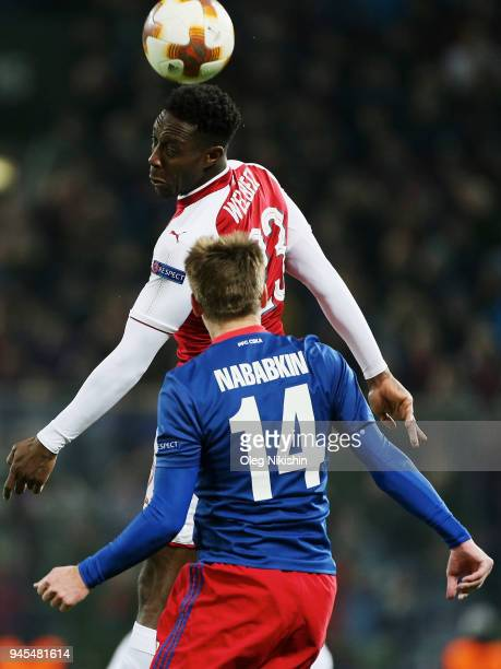 Kirill Nababkin of PFC CSKA Moskva vies for the ball with Danny Welbeck of Arsenal FC during the UEFA Europa League quarter final leg two match...
