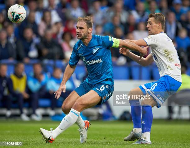 Kirill Panchenko of FC Dynamo Moscow and Branislav Ivanovic of FC Zenit Saint Petersburg vie for the ball during the Russian Premier League match...
