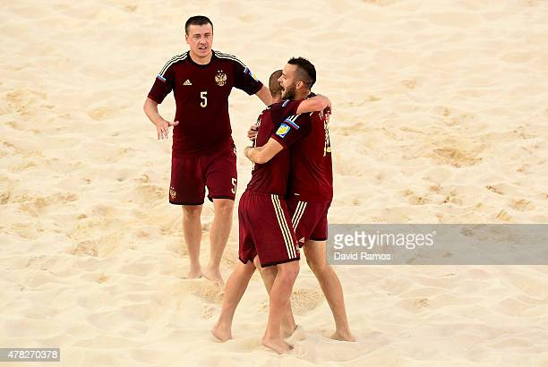 Kirill Romanov Anton Shkarin and Artur Paporotnyia of Russia celebrate during the Men's Beach Soccer Group B match between Hungary and Russia on day...