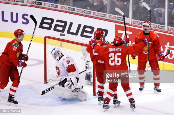 Kirill Slepets of Russia celebrates with teammates Ivan Muranov Artyom Galimov and Alexander Romanov after a third period goal on goaltender Luca...