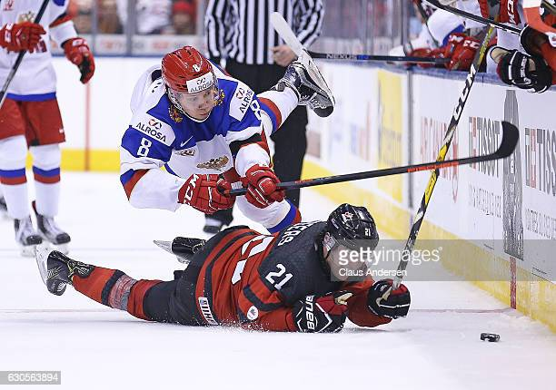 Kirill Urakov of Team Russia battles Blake Speers of Team Canada during a game at the the 2017 IIHF World Junior Hockey Championships at the Air...
