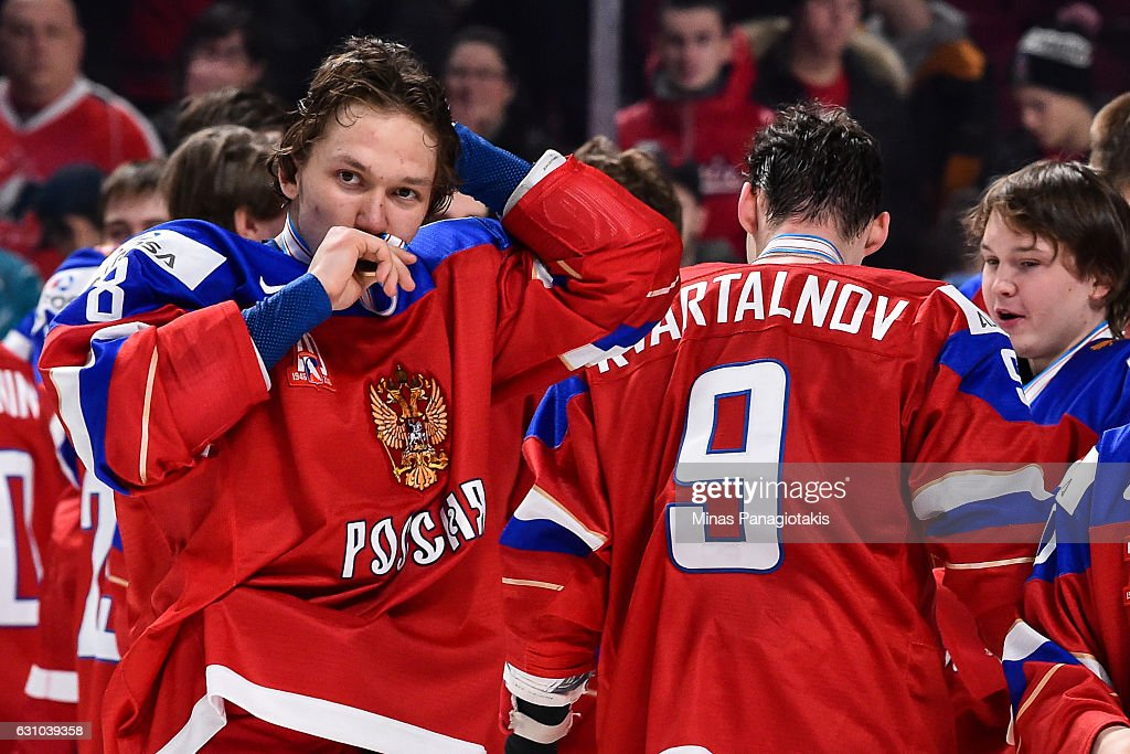 Kirill Urakov #8 of Team Russia kisses his bronze medal during the 2017 IIHF World Junior Championship bronze medal game against Team Sweden at the Bell Centre on January 5, 2017 in Montreal, Quebec, Canada. Team Russia defeated Team Sweden 2-1 in overtime to win the bronze medal.