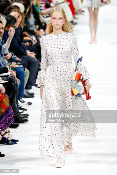 Kirin Dejonckheere walks the runway during the Valentino show as part of the Paris Fashion Week Womenswear Spring/Summer 2018 on October 1 2017 in...