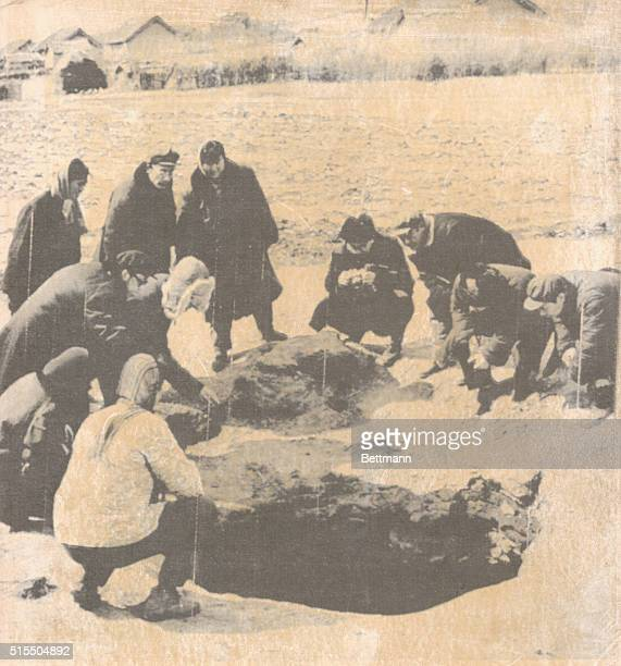 Members of the Chinese Academy of Sciences examine into the big hole 2 meters in diameter and 65 meters in depth which was made on last March 8th in...