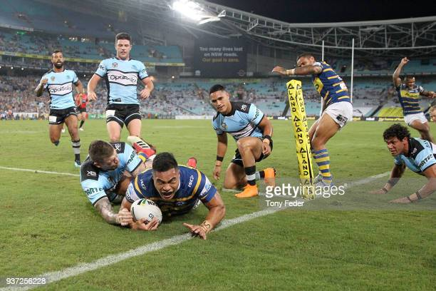 Kirisome AuvaÕa of the Eels scores a try during the round three NRL match between the Parramatta Eels and the Cronulla Sharks at ANZ Stadium on March...