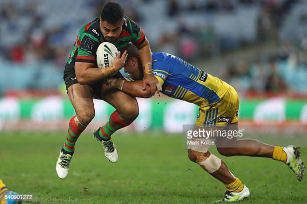 Kirisome Auva'a of the Rabbitohs is tackled by Vai Toutai of the Eels during the round 15 NRL match between the South Sydney Rabbitohs and the...
