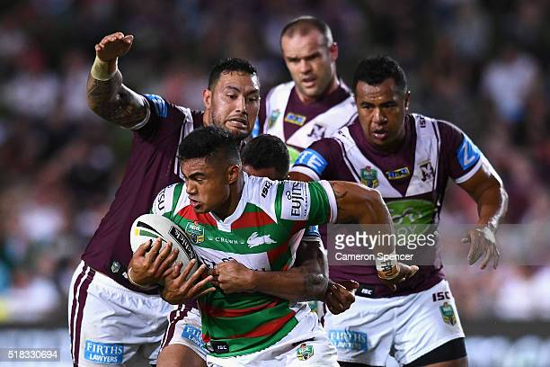 Kirisome Auva'a of the Rabbitohs is tackled during the round five NRL match between the Manly Sea Eagles and the South Sydney Rabbitohs at Brookvale...