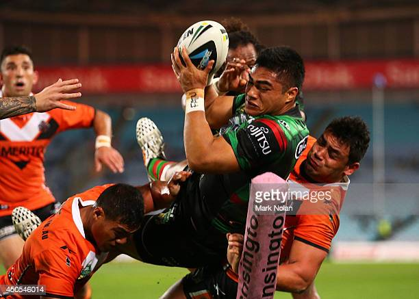 Kirisome Auva'a of the Rabbitohs is taken into touch while attempting to score during the round 14 NRL match between the South Sydney Rabbitohs and...