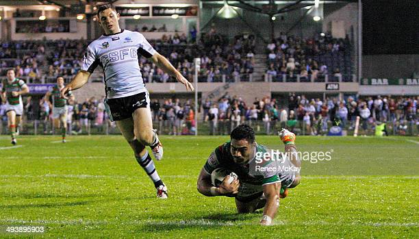 Kirisome Auva'a of the Rabbitohs scores a try during the round 11 NRL match between the Cronulla-Sutherland Sharks and the South Sydney Rabbitohs at...