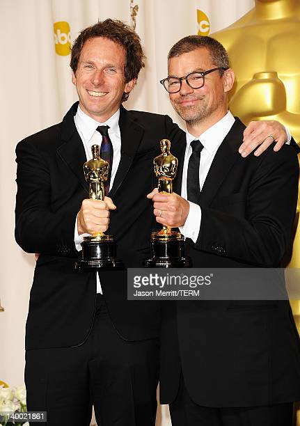 Kirk Baxter and Angus Wall winners for Best Film Editing for 'The Girl with the Dragon Tattoo' pose in the press room at the 84th Annual Academy...