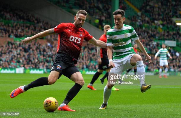 Kirk Broadfoot of Kilmarnock clears the ball from Michael Johnson of Celtic during the Ladbrokes Scottish Premiership match between Celtic and...