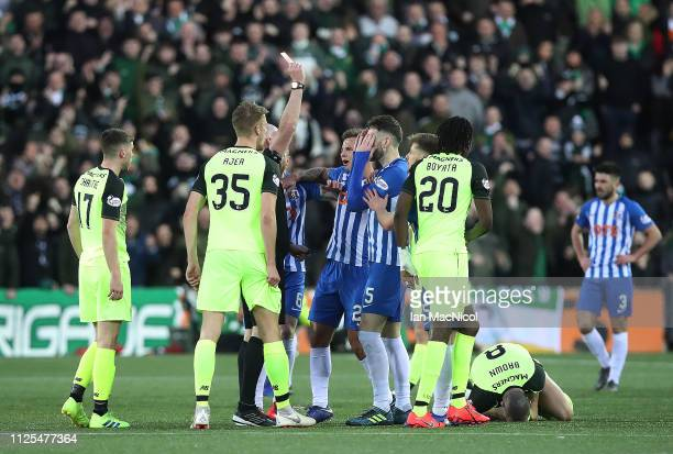 Kirk Broadfoot of Kilmarnock reacts to his second yellow card and vsubsequently being sent off during he Scottish Ladbrokes Premiership match between...