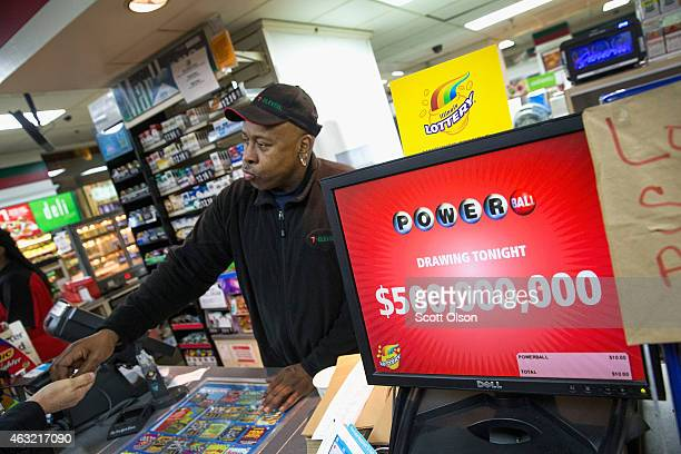 Kirk Cook rings up a Powerball lottery ticket sale at a 7Eleven store on February 11 2015 in Chicago Illinois Ticket sales have caused the jackpot to...