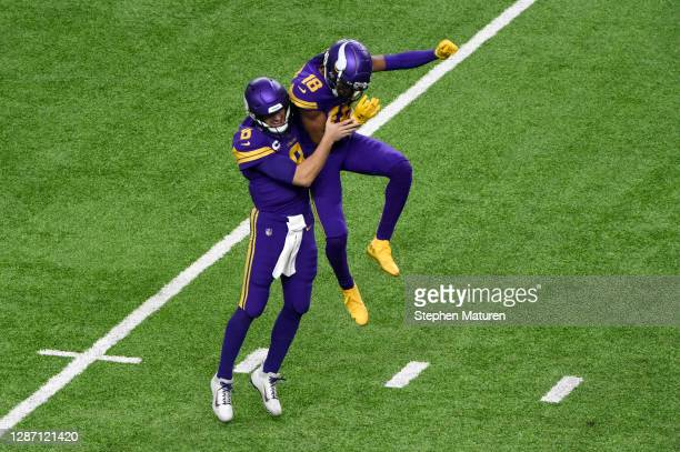 Kirk Cousins and Justin Jefferson of the Minnesota Vikings celebrate following a touchdown catch during their game against the Dallas Cowboys at U.S....