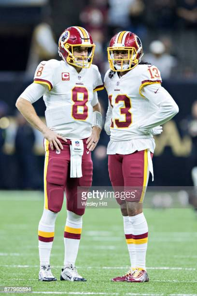 Kirk Cousins and Maurice Harris of the Washington Redskins warming up before a game against the New Orleans Saints at MercedesBenz Superdome on...