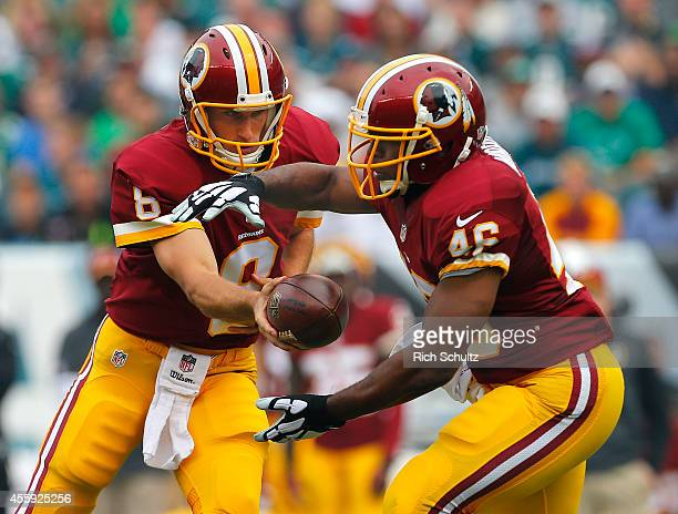 Kirk Cousins hands off to Alfred Morris of the Washington Redskins during a football game against the Philadelphia Eagles at Lincoln Financial Field...