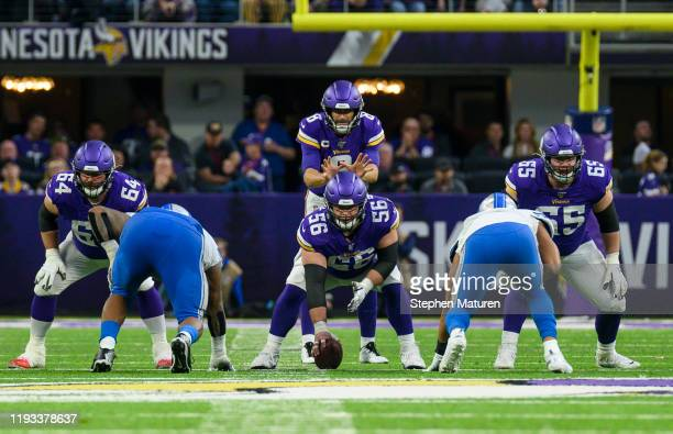 Kirk Cousins of the Minnesota Vikings at the line of scrimmage in the third quarter of the game against the Detroit Lions at US Bank Stadium on...