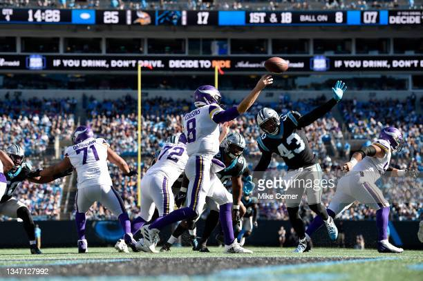 Kirk Cousins of the Minnesota Vikings attempts a pass during the fourth quarter against the Carolina Panthers at Bank of America Stadium on October...