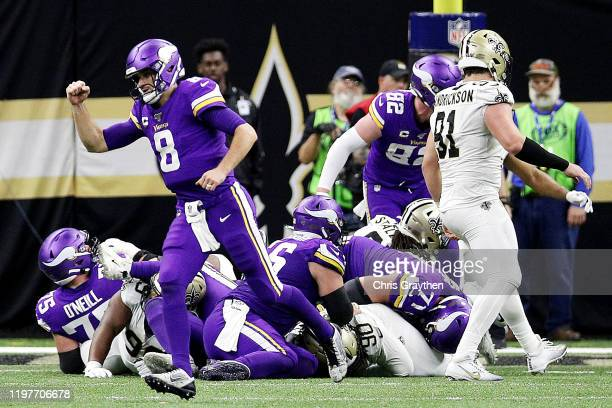 Kirk Cousins of the Minnesota Vikings celebrates after a third quarter rushing touchdown by Dalvin Cook against the New Orleans Saints in the NFC...
