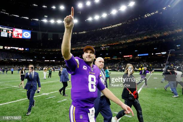 Kirk Cousins of the Minnesota Vikings celebrates after defeating the New Orleans Saints 2620 during overtime in the NFC Wild Card Playoff game at...