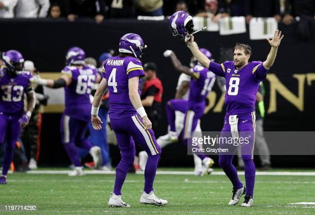 Kirk Cousins of the Minnesota Vikings celebrates with teammates after defeating the New Orleans Saints 26-20 during overtime in the NFC Wild Card...