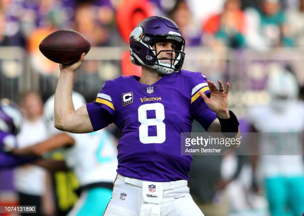 Kirk Cousins of the Minnesota Vikings drops back to pass the ball in the second quarter of the game against the Miami Dolphins at US Bank Stadium on...