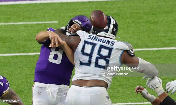 Kirk Cousins of the Minnesota Vikings gets hit by Jeffery Simmons of the Tennessee Titans in the fourth quarter at U.S. Bank Stadium on September 27,...