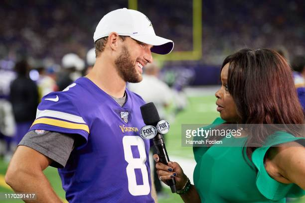 Kirk Cousins of the Minnesota Vikings is interviewed by Pam Oliver during the preseason game against the Seattle Seahawks at US Bank Stadium on...