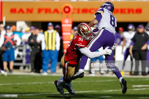 Kirk Cousins of the Minnesota Vikings is sacked by Arik Armstead of the San Francisco 49ers during the first half of the NFC Divisional Round Playoff...